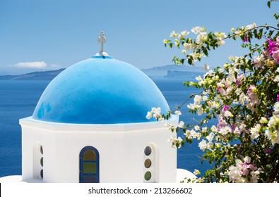 Iconic church with blue cupola in Oia, Santorini, Cyclades, Greece