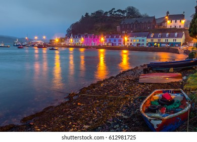 Iconic Colorful Houses of Portree, Isle of Skye, Scotland During Evening With Fishing Boat On Beach And View Of Portree Harbour Area