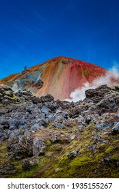 Iconic colorful rainbow volcanic mount Brennisteinsalda in Landmannalaugar mountains in Iceland. Summer, dramatic scenery with blue sky and smoky lava field