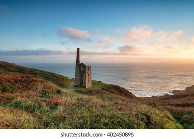 An iconic Cornish Engine House perched on cliffs at Rinsey Head on the Cornwall coast