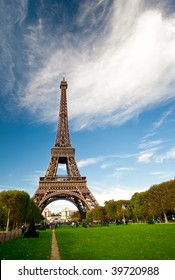 The iconic Eiffel tower in Paris, France as viewed from the beautiful Champs de Mars. Ample copy space at top and right side.
