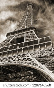 Iconic Landmark Steel Structure of Eiffel Tower in Paris France Sky and Clouds in Sepia