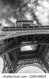 Iconic Landmark Steel Structure of Eiffel Tower in Paris France Sky and Clouds in black and white