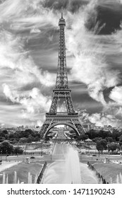 Iconic Landmark Steel Structure of Eiffel Tower in Paris France and Trocadero Fountains in black and white.