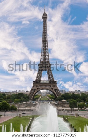Iconic Landmark Steel Structure of Eiffel Tower in Paris France and Blue Sky and Clouds