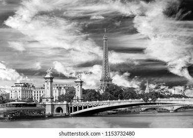 Iconic Landmark Steel Structure of Paris France Eiffel Tower, Pont Alexander III Bridge and Blue Sky and Clouds in black and white.