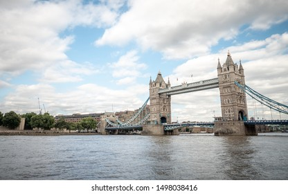The iconic London landmark Tower Bridge crossing the River Thames.  Viewed from the south bank towards the Tower of London.