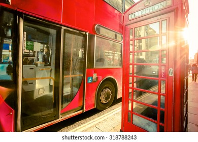 Iconic London with red phonebooth and double decker bus.