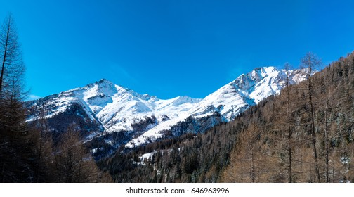 Iconic mountains Blauspitze and Kendelspitze in Austria's Hohe Tauern nature reserve, as seen from the Teischnitz valley near Kals am Grossglockner, on a sunny, cold winter's day.