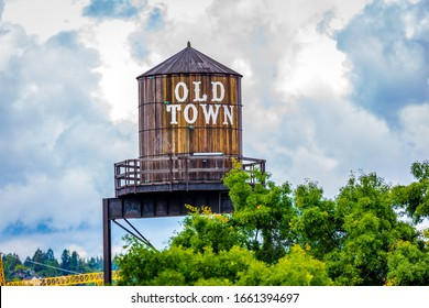 Iconic old town sign on water tank, in downtown Portland, Oregon