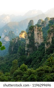 Iconic quartzite sandstones pillars & peaks in Wulingyuan / Zhangjiajie National Forest Park in Hunan Province, China. Unique mountain landscape inscribed as UNESCO World heritage site.