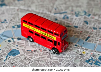 The iconic red bus miniature on the map of London