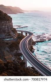 The iconic Sea Cliff Bridge wrapping around the beautiful Australian land/ Sea Cliff Bridge
