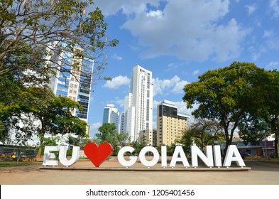Iconic sign of I love Goiania among trees and buildings at the public Sun Square in Goiania, Goias, Brazil