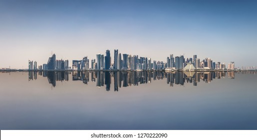 The iconic skyline of Doha, Qatar, with the modern skyscrapers with reflections on the sea