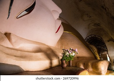 Iconic statue of Buddha in one of the temples in Bagan, Myanmar. Many historic pagodas contain preserved statures of Buddha. Reclining Buddha is Burma.