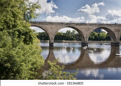 The iconic Stone Arch Bridge over the Mississippi River in Minneapolis, MN
