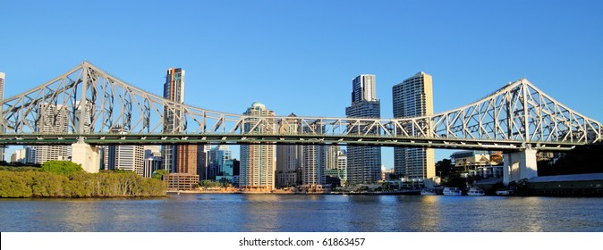 The iconic Story Bridge spanning the Brisbane River in Brisbane Australia at sunrise.