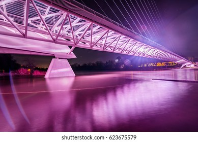 The iconic Sundial Bridge in Redding, California - the main tiled area completely flooded over from the engorged Sacramento River.