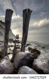 Iconic timber piles at chalk cliff of Ruegen island Germany with dramatic sky
