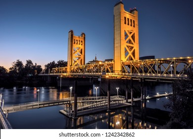 The iconic Tower bridge spanning the Sacramento River, illuminated at sunset.