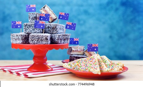 Iconic traditional Australian party food, Lamington cakes and Fairy Bread, on a red, white and blue background.