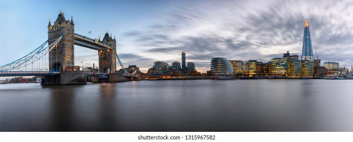 The iconic urban skyline of London after sunset: from the Tower Bridge to London Bridge