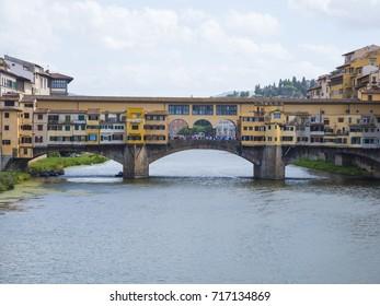 Iconic Vecchio Bridge in Florence over river Arno called Ponte Vecchio