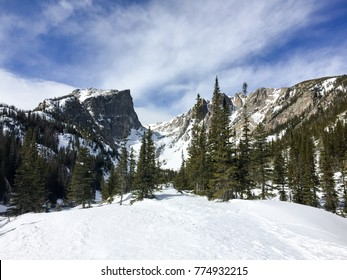 Iconic view of Dream Lake, Hallett and Otis Peaks on a sunny winter day in Rocky Mountain National Park, Colorado