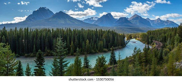 Iconic view of Morants Curve where the Canadian Pacific Railway runs along the stunning Bow River with the beautiful Canadian Rockies in the background, Banff National Park, Alberta, Canada