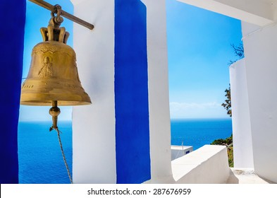 Iconic view on golden bell and typical blue-white church on Greek Island Kalymnos, Greece