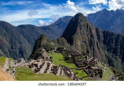 Iconic Views of the Inca Ruins at Machu Picchu, Peru Which Were Constructed in the 1400s and Abandoned Within a 100 Years.  The Mountain Peak of Huayna Picchu is in the Background.