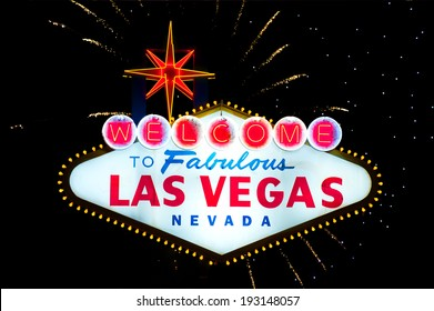 Iconic Welcome to Fabulous Las Vegas sign with fireworks in the back