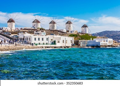 Iconic windmills viewpoint during a clear and bright summer sunny day along the blue sea and coasts of Mykonos, Greece