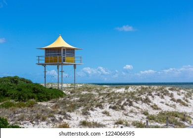 The iconic yellow life guard tower at Semaphore beach with a blue sky in the background Semaphore South Australia on 7th November 2018