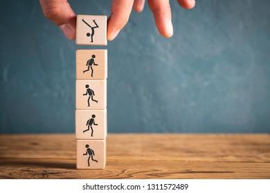 Icons on cubes symbolizing sports on wooden background