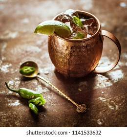 Icy Cold Moscow Mule cocktail with Ginger Beer and Vodka and chili pepper