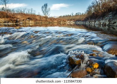 the icy flow of the river Cervo in the North of Italy