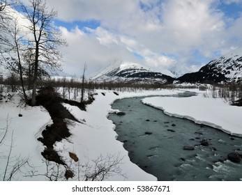 Icy glacier river in Alaska