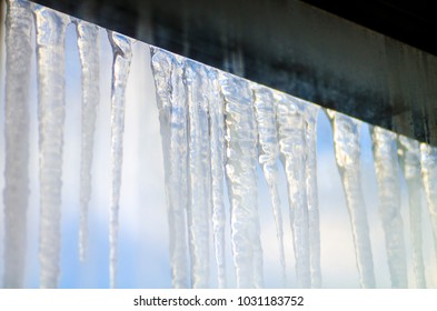 Icy icicles hang on the window