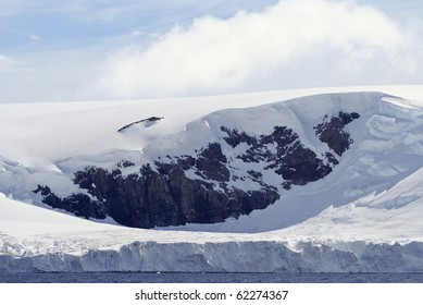 Icy Landscape with snow capped mountains. Taken at Antarctica on  a sunny day.