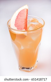 Icy lemonade glass with fruits on white background