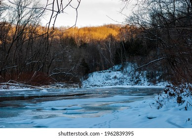 Icy river at sundown on a sunny winter  day