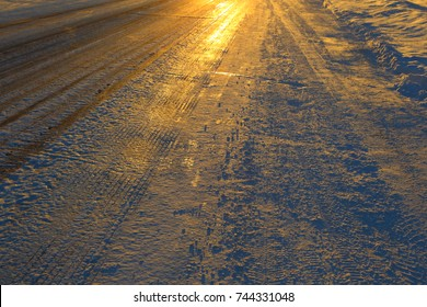 The icy road. Frosty winter sunset.