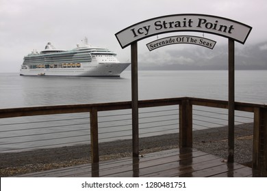 ICY STRAIT POINT, ALASKA : 12 JULY 2009 : A large cruise ship The Serenade Of The Seas moors off the small port of Icy Strait Point in Alaska on a misty and foggy day