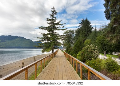 Icy Strait Point, Hoonah, Alaska, USA - July 31th, 2017: The wooden boardwalk platform of Icy Strait Point which connect the Hoonah Cruise Terminal with the Warehouse Shops.