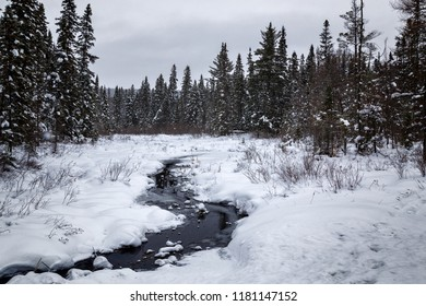An icy stream after a heavy snowstorm in Ontario Canada that tranformed the landscape into a winter wonderland