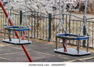 Icy swing on the playground