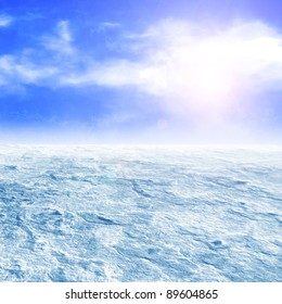 Icy wasteland of the clouds in the sky and bright sun