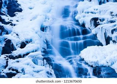 Icy waterfall in the Adamello Brenta natural park, Nardis waterfalls, Trentino, Italy